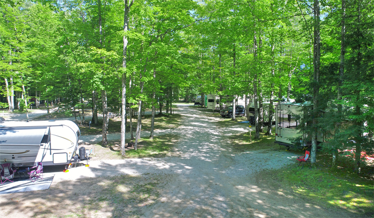 Newberry, MI Campgrounds with Heated Pool | UP Campground with Pool |Newberry, Michigan Campgrounds with Pool | Upper Peninsula Campgrounds Newberry, MI Campgrounds | Newberry, Michigan Campgrounds with Pool | Upper Peninsula Campgrounds | UP Campgrounds near Golfing | Newberry MI Campgrounds near Attractions | Our UP Campground has a large outdoor pool and features large, shaded full hookup rv campsites, tent camping sites and rental cabins.